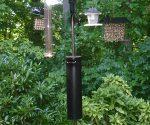 Homemade bird feeder baffle on pole