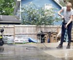 Chelsea pressure washes the patio